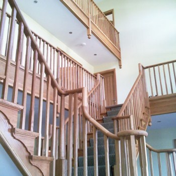 Oak cut string staircase with continuous handrail & square stop chamfered balustrade, Linton