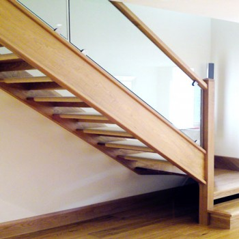 Oak closed string open rise staircase with contemporary glass balustrade, Linton