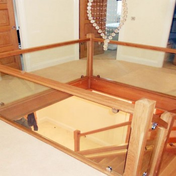 Oak Closed String Staircase with Glass Balustrade